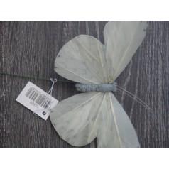 Fjäril på stick vit och grå