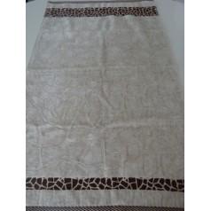 Handduk i bege mönster